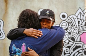 Foster youth student and youth coach hugging